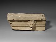 Limestone cornice with a lion's head