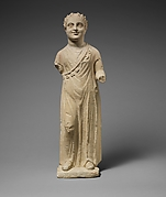 Limestone statuette of a boy with a chain of amulets