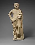 Limestone statuette of a boy as a votary