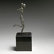 Bronze statuette of a runner