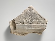 Limestone finial of a funerary stele