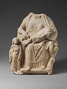Seated limestone kourotrophos with another child standing