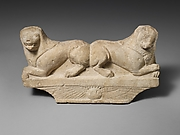 Limestone finial of a funerary stele with two recumbent lions