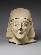 Limestone head of a bearded male with a plain headdress