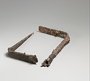 Three fragmentary iron fire-rakes