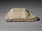 Limestone plinth with the left foot of a statue of Zeus