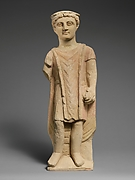 Limestone statuette of a boy holding a pyxis