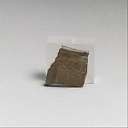 Terracotta rim fragment with incised lines and punctations