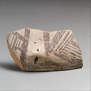 Terracotta rim fragment with lug and linear decoration