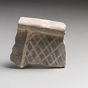 Terracotta rim fragment with cross-hatching