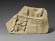 Limestone votive relief