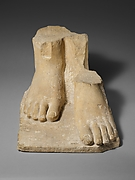 Limestone plinth with the feet of a colossal male statue