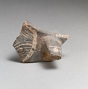 Terracotta rim and handle fragment from a jug
