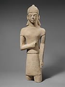 Limestone votary of a bearded male in Egyptianizing dress