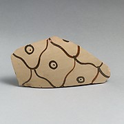 Terracotta vessel fragment with net pattern and dots within circles