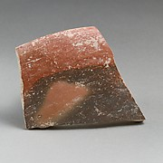 Terracotta rim fragment from a shallow bowl