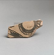 Terracotta vessel fragment with curvilinear decoration