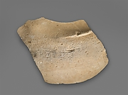 Fragment of a limestone votive vase
