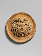 Terracotta reilef roundel with head of Medusa
