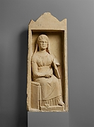 Limestone funerary monument with a seated woman
