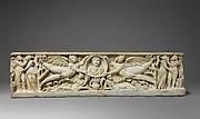 Marble sarcophagus with flying erotes holding a clipeus portrait