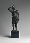 Reproduction of a bronze statuette of a man