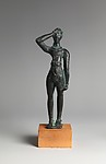 Reproduction of a bronze votive statuettte of a man