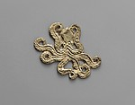Reproduction of a gold octopus ornament