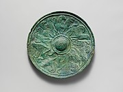 Bronze shield boss with griffin and sphinx frieze