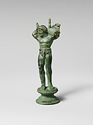 Bronze statuette of a youth carrying a pig