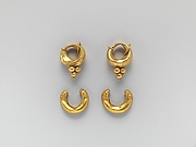 Gold boat-shaped earrings with lions' heads