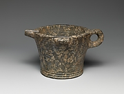 Serpentine bowl with spout and handle
