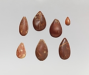 Pendants: cowrie shells
