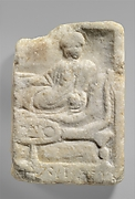 Fragment of a marble votive relief dedicated to a hero
