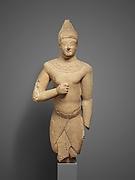 Limestone male figure in Egyptian dress