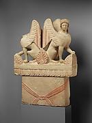 Limestone funerary stele (shaft) surmounted by two sphinxes