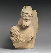Limestone finial of a votive stele (?) with a lion and a male sphinx