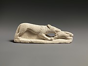 Limestone statuette of a coursing hound seizing a hare