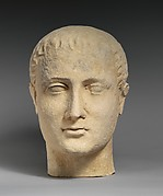 Limestone head of a beardless male votary