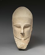 Limestone bearded head with a Corinthian helmet