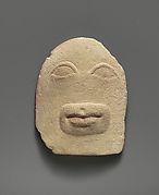 Limestone votive relief of eyes and a mouth