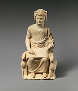 Limestone statue of an enthroned youth