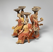 Terracotta group of women seated around a well head