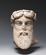 Marble head of a god, probably Dionysos
