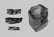 Group of 3 worked obsidian fragments and a raw obsidian lump