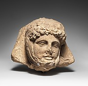 Limestone relief head of a Persian