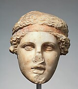Marble head of a deity wearing a Dionysiac fillet