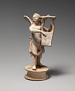 Terracotta statuette of Eros playing a lyre