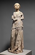 Marble and limestone statue of an attendant