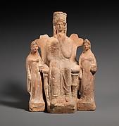 Terracotta statuette of an enthroned  goddess between two attendants